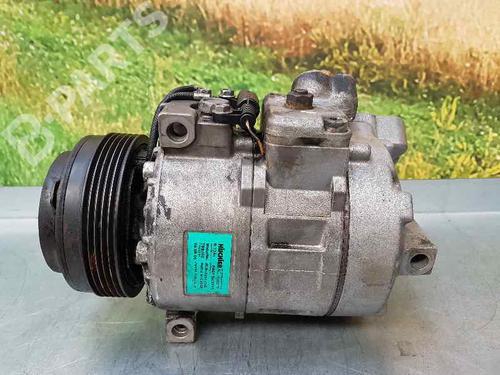 AC Kompressor BMW 5 (E39) 523 i 6911340 | HISCHIER | 13024782